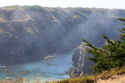 Afternoon fog over cliffs