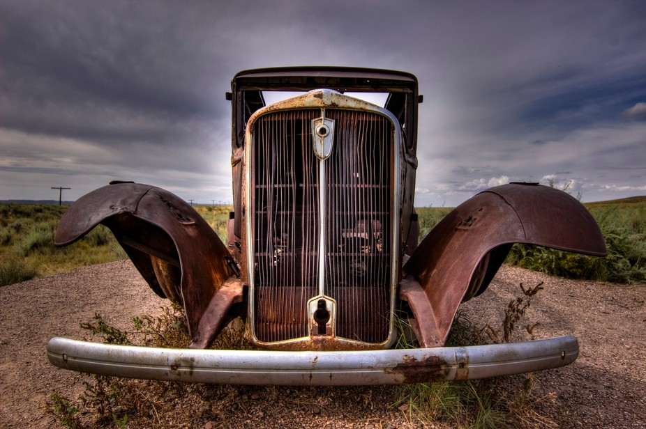 Old car sitting by the road on Old Route 66 between the Petrified Forest and the Painted Desert i...