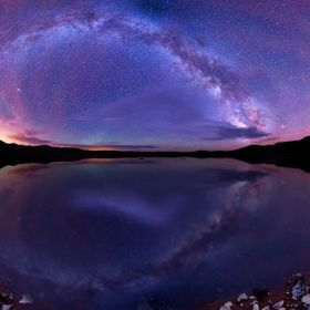 The Milky Way reflected in one awesome lake somewhere deep within Colorado. I've been working on this photo for months. When I originally sh...