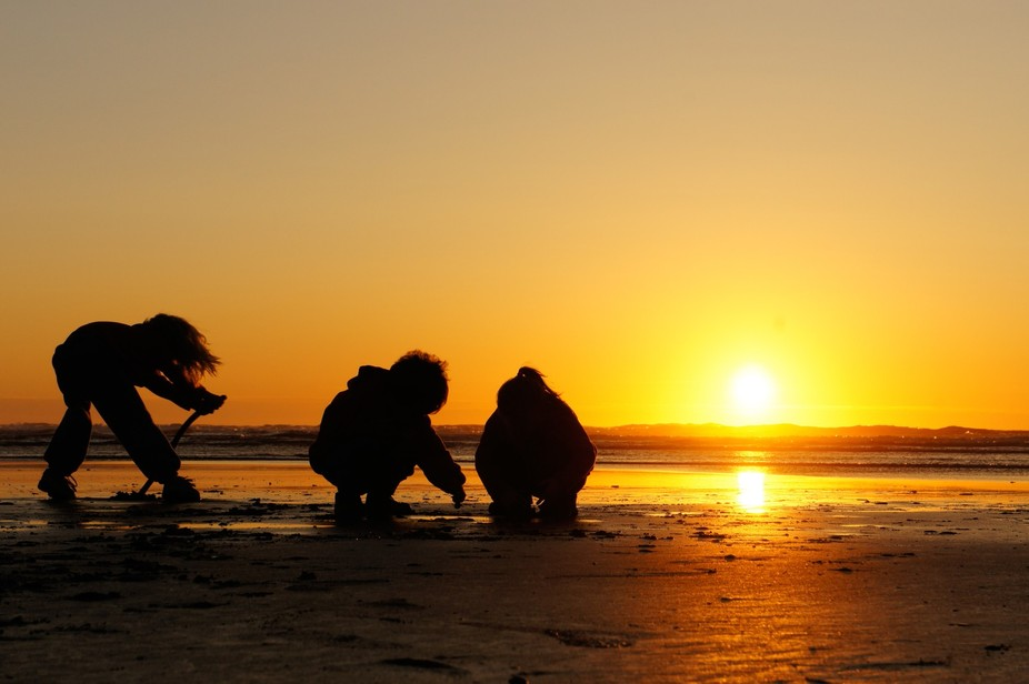 The kids were bored with the sunset and decided to play in front of the camera and the shot just ...