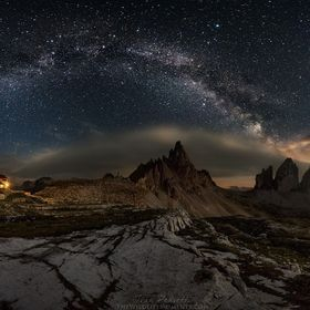 Panoramic with the MOONSET at The Three Peaks of Lavaredo (Italy), called also Drei Zinnen, in a night of July at 2450m, during a photographic we...