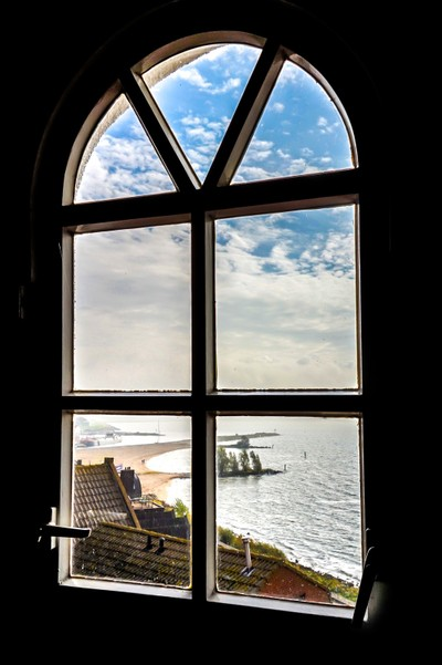 View of the Historic Fishing Village of Urk  through the Lighthouse Window
