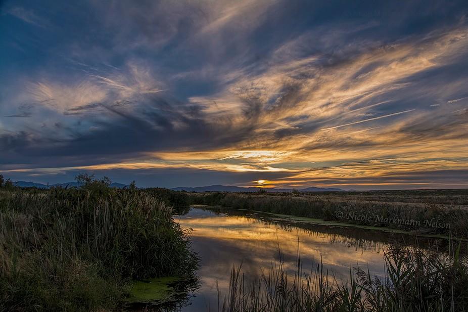 A beautiful sunset at the canal Northern Utah at the Willard Lake