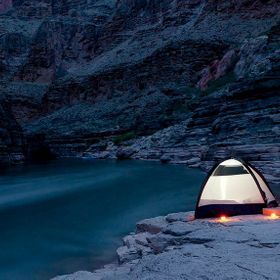 A night shot of our tent along the Colorado river in the Grand Canyon. Nothing like seeing the Canyon from the bottom up.   Bill Klipp Check out ...