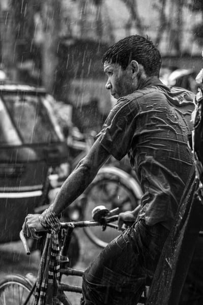 Rickshaw puller in the rain
