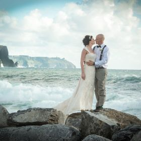 Beautiful American couple came all the way to Ireland to get married. Here they are very much in love at the famous Cliffs of Moher