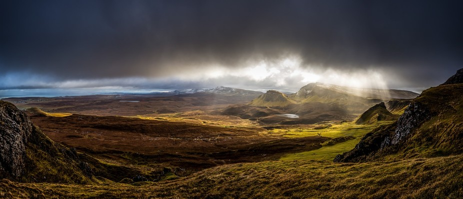 A panorama of the incledible Quiraing landscape captured just as the sun broke through the moody ...