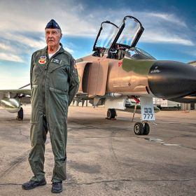 Posed by the very jet he flew in combat, retired USAF Col Drury Callahan talks about his years of service during the Vietnam war.
