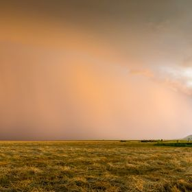 A panorama of a thunderstorm moving across the plains at Bear Butte, SD.