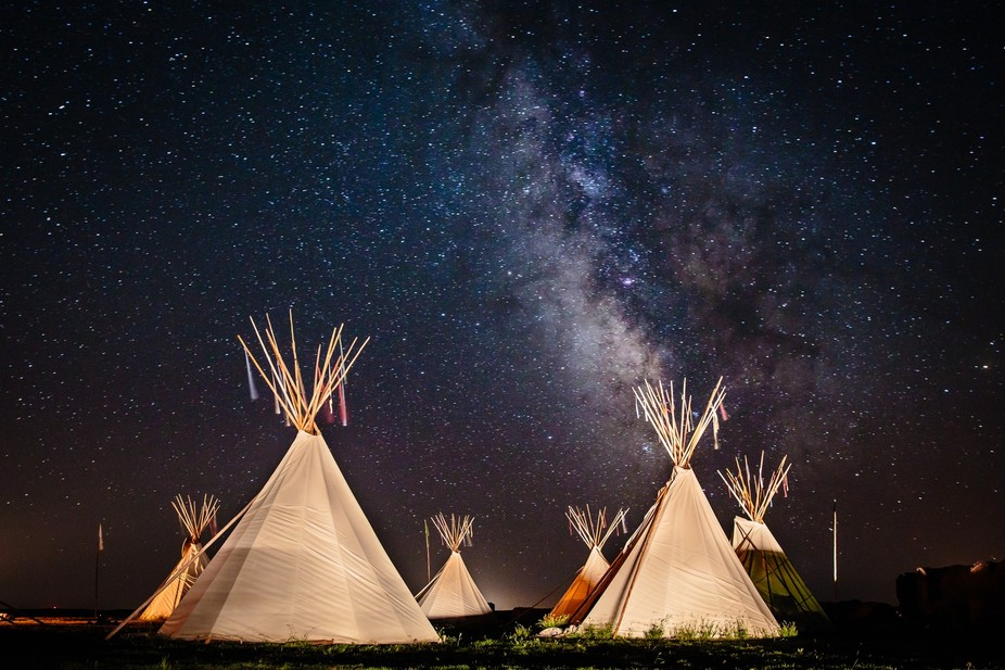 Teepee's under the Milky Way at the Oyate Wahacanka Woecun Spiritual Camp near Winner, S...
