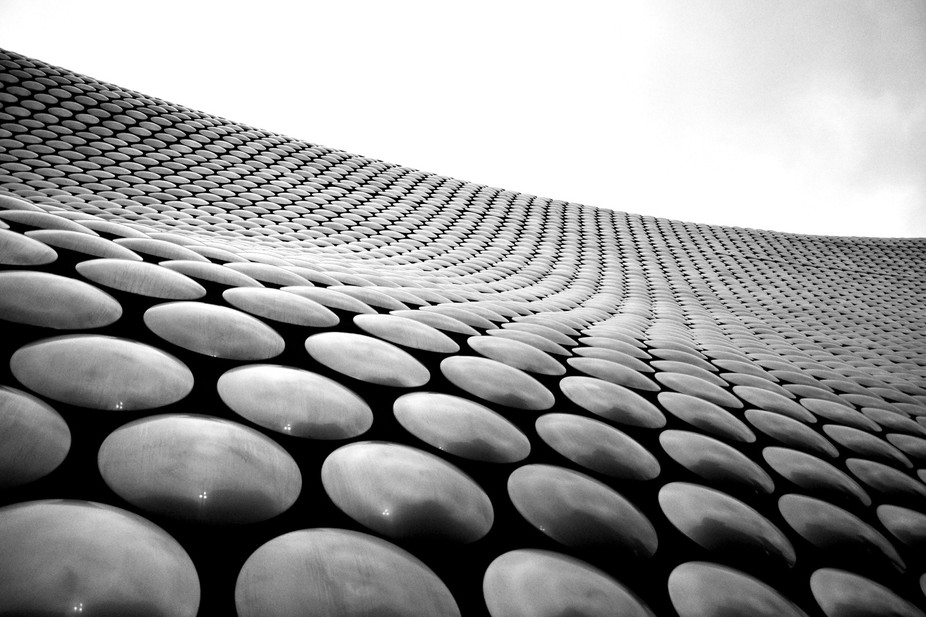 An abstract black and white shot of the Selfridges building in Birmingham