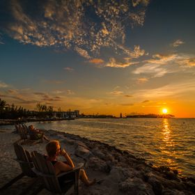 My son watching the sunset at Tranquility Bay Resort, Marathon Key, Florida and dreading the start of school next week.