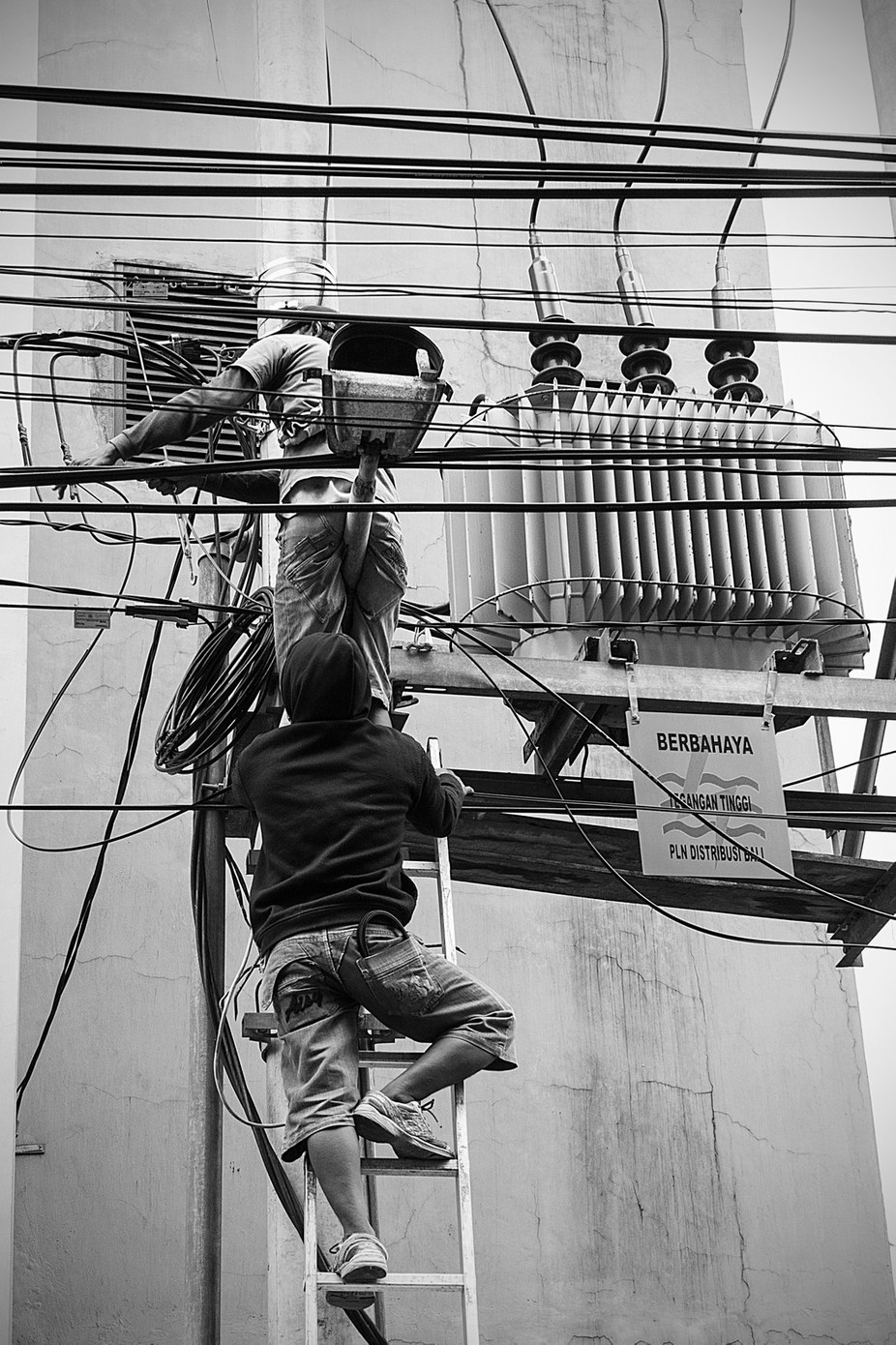 Not big on safety. Power line workers Bali 2015