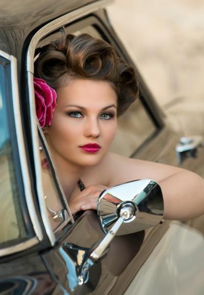 Gorgeous Model driving a Vintage Car
