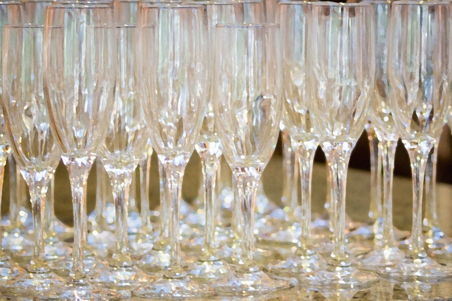The champagne flutes for a toast at this wedding were all arranged on the counter.  The reflected...