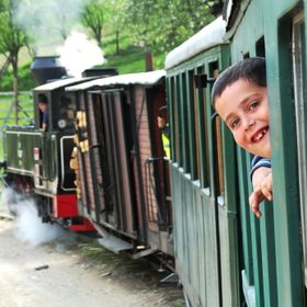 This kid simply smiled to my camera while enjoying a ride on an old steam train