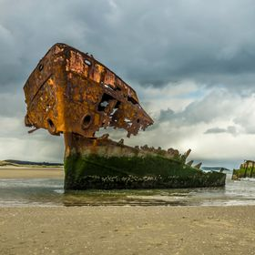 M.V. Irish Trader, ran aground on Baltray beach, County Louth Ireland during a storm in the early 1970's.