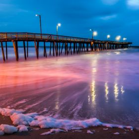 The pier at Virginia Beach. I've never seen so much sea foam as I did the night I took this shot. The wind was strong and waves were huge to...