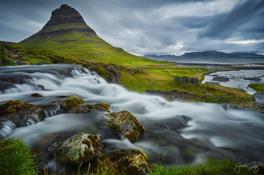 Kirkjufell is widely known for its symmetry. I decided to get close on this shot to make the wate...