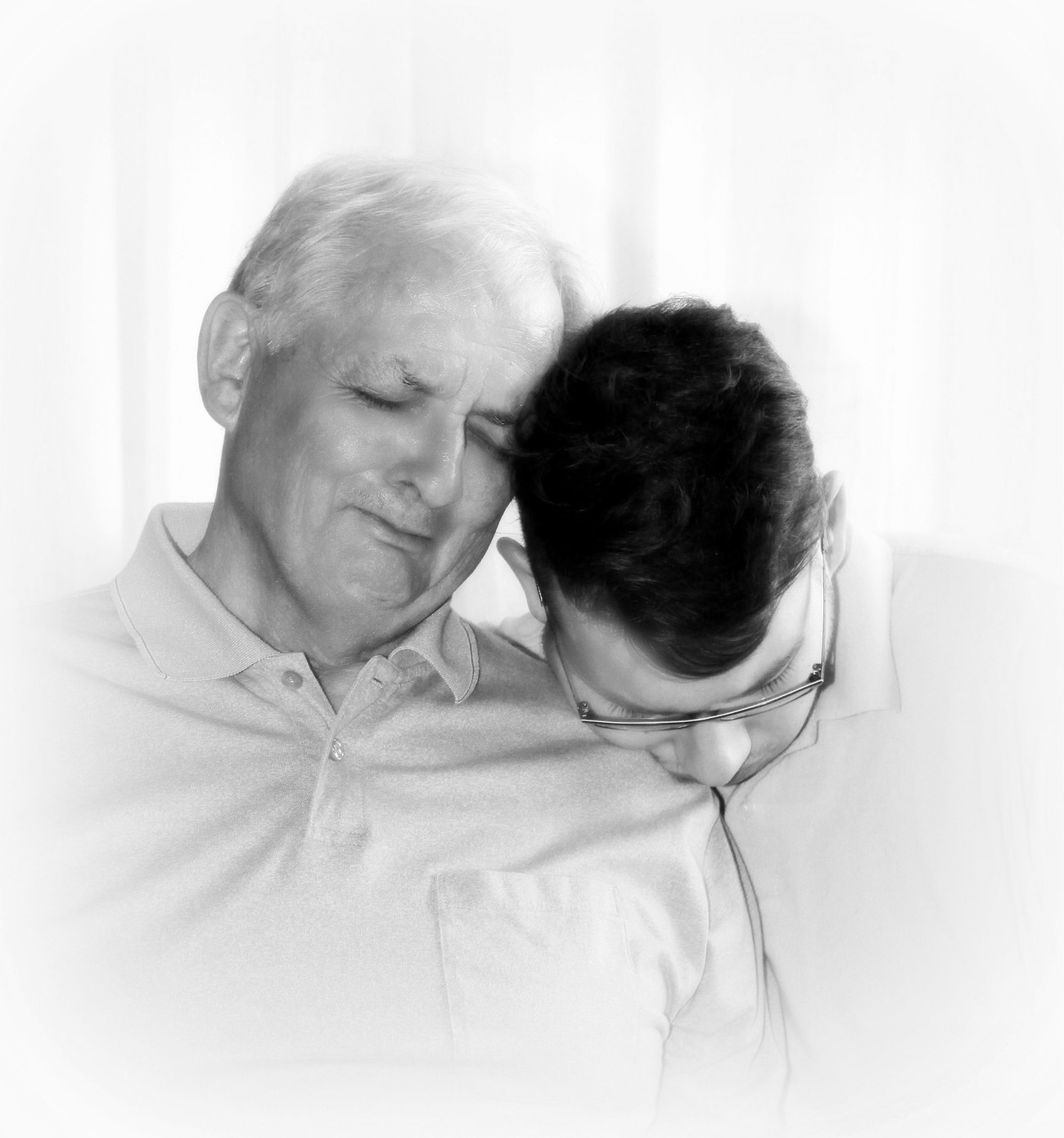 A father and son in a tender moment because of an illness