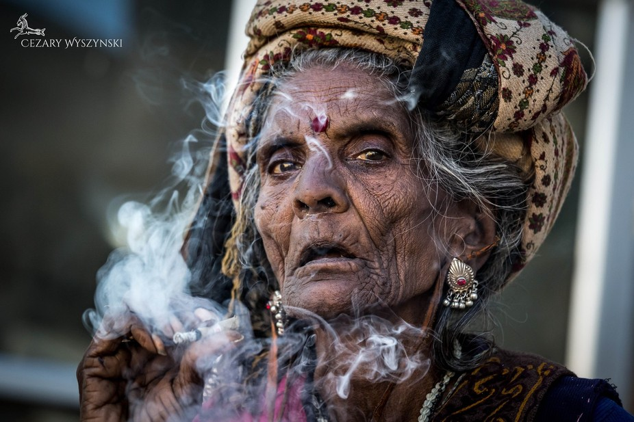 For more check here : https://www.facebook.com/cezarywyszynskiphoto  Old woman having a break fro...
