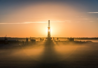 Sunset Over The Oil Field