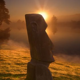 "Modeled like one of the colossal ""Moai"" stone statues on Easter Island. Seen in Germany at the river Ruhr, on a foggy September day. Be..."