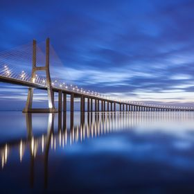 the sunrise at Vasco da Gama bridge, Lisbon - Portugal This is the biggest bridge in Europe and the 9th bigger in the world
