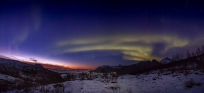 Aurora dancing over the sunset