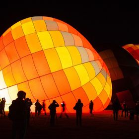 Early in the morning, the hot air balloons were heated up for launch of the dawn patrol. The roaring sound of fiery flame and its bright orange c...