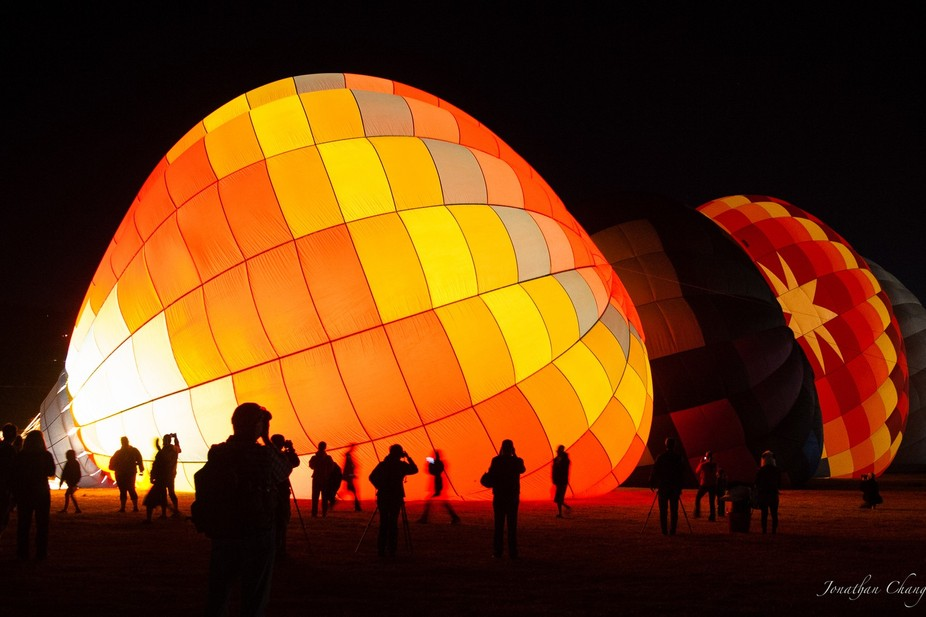 Early in the morning, the hot air balloons were heated up for launch of the dawn patrol. The roar...