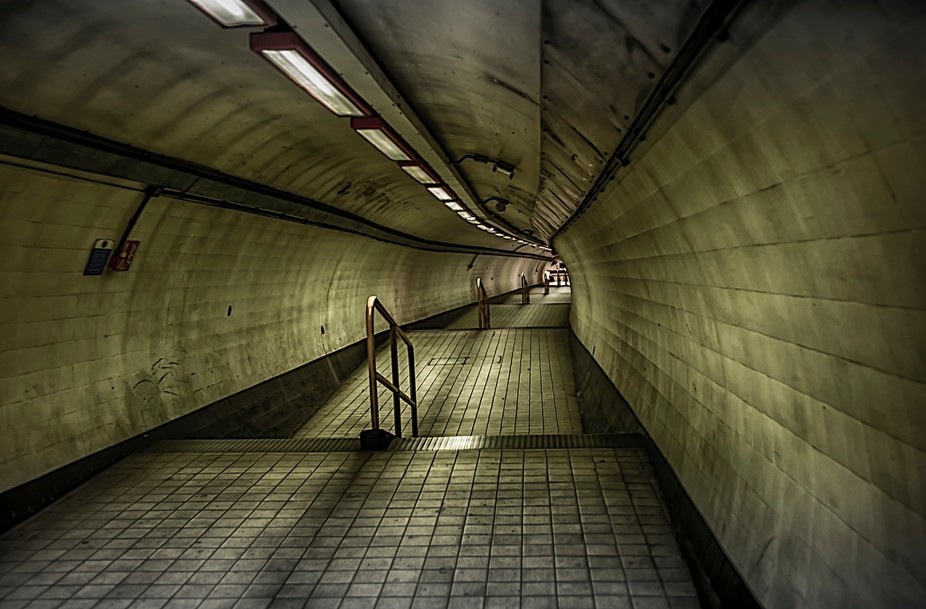 Taken on a very quiet day on the stairway down to the Waterloo and City Line on the London Underg...