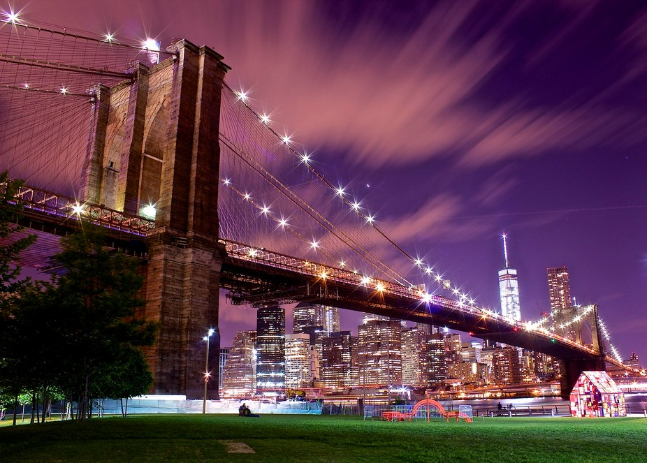 The Brooklyn Bridge is a hybrid cable-stayed/suspension bridge in New York City and is one of the...