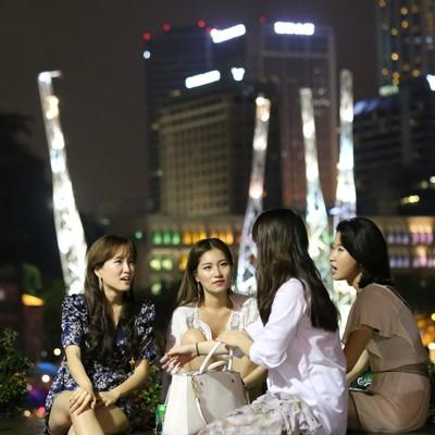 Four girls sat on the bridge