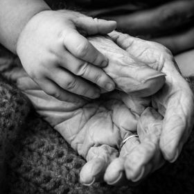 This is a photo of my 2 month old baby girl holding hands with her Great Grandmother who past away at the age of 94 only a couple of weeks after ...