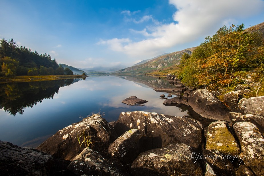 Autumn morning at the foothills of Snowdon, i love how reflective the water is