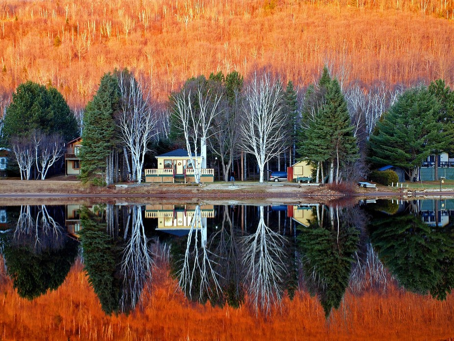 A colorful November sunset on Lac Blanc, Laurentides, Quebec, Canada.