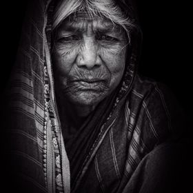 An old Indian woman shows dignity in here face.