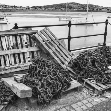 Conwy quayside in North Wales celebrates its fishing industry, past and present. Here is a pile of chains and pallets used by the boats that work from the quay.