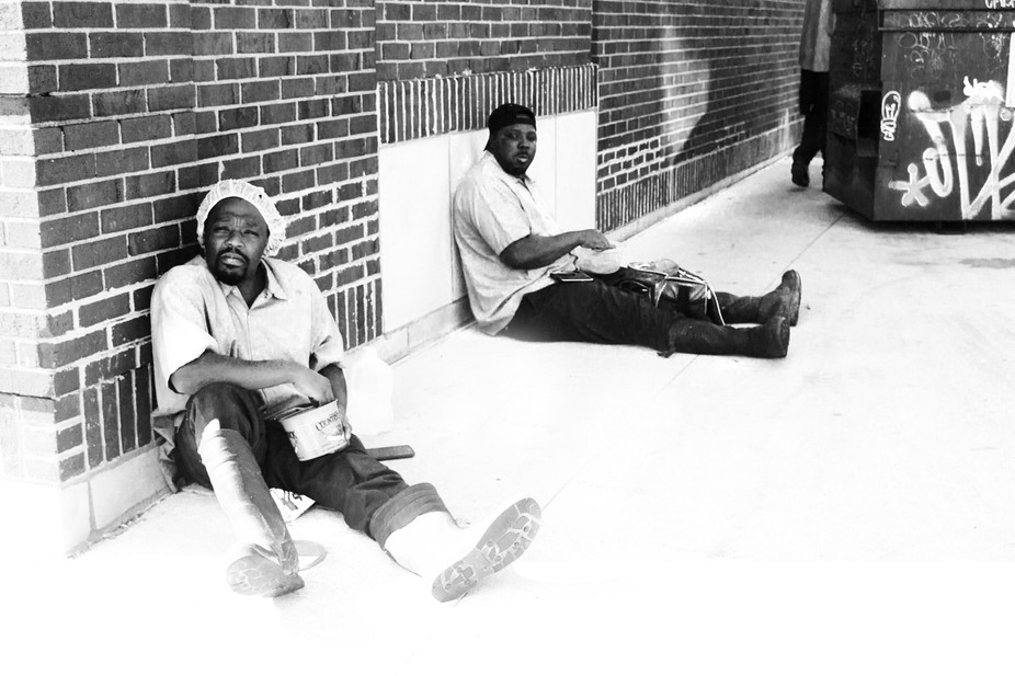 Taken in the heart of Detroit, this photo shows two men taking their lunch break. I was lucky to ...