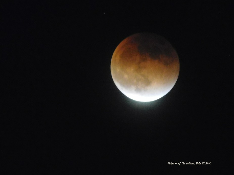 The Moon Channging Colors during the Eclipse... Taken by my 15 year old daughter Paige Hopf!