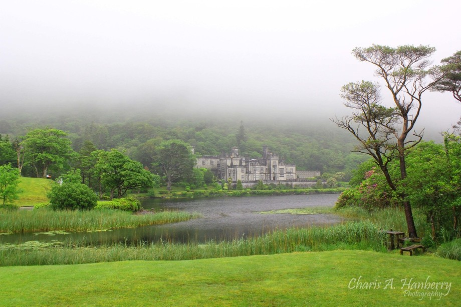 Kylemore Abbey sits above Lake Pollacapall in Connemara, Ireland. The property is a beautiful wal...