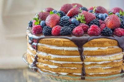 Six-layer cream & chocolate cake with fresh berries