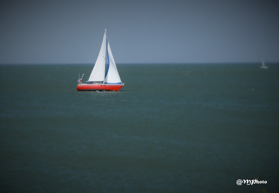 Little red ship on the sea