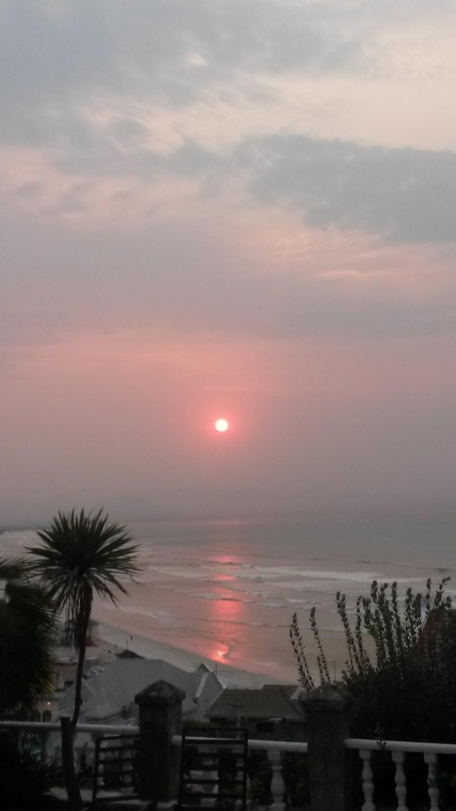 Amazing sunrise over Surfers Corner in Muizenberg