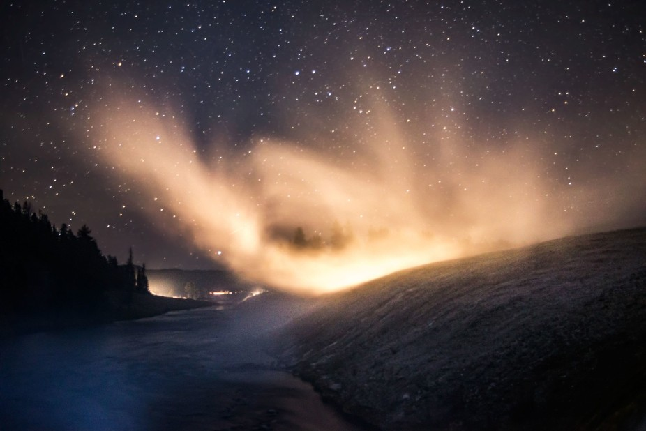 The image was made just after evening twilight at the Midway Geyser Basin in Yellowstone National...