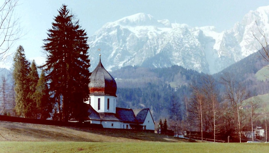 I was hiking in the hills near Salzburg, Austria when I came upon a church that had a backdrop of...