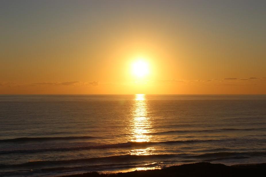 Sleepy photographer captures image of beautiful sunrise over Melbourne Beach in Florida.