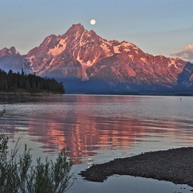 Sunrise with moon set Jackson Lake at RV park, Grand Teton National Park, WY