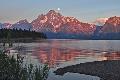 Sunrise with moon set Jackson Lake at RV park